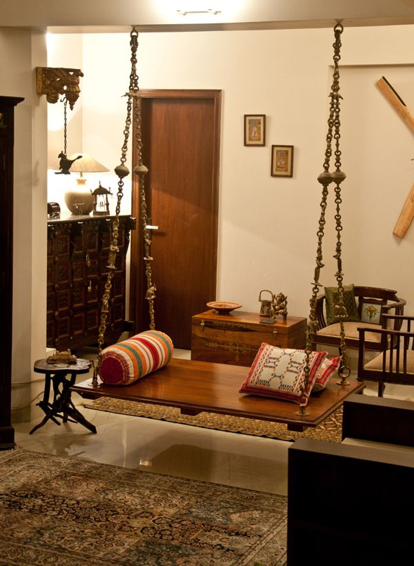 Oonjal wooden swings in south indian homes for Living room jhula
