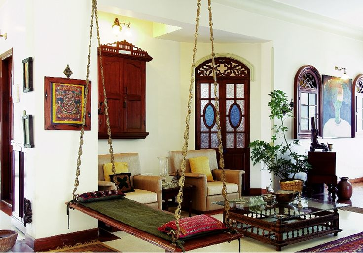 Oonjal wooden swings in south indian homes for Indian traditional interior design ideas